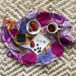 blooming flower tea towel with berries on plate
