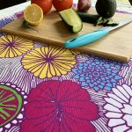 simple things seen with joy - flower table towel with chopping board and vegetables