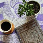 modal design notebook in a purple tea towel