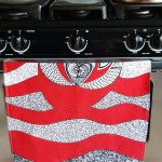 red kitchen towel in a gas range oven