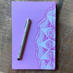 lavender Cosmic journal with pen on top