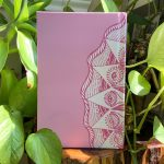 pink Cosmic journal within plants
