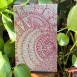 pink Cosmic journal with plants
