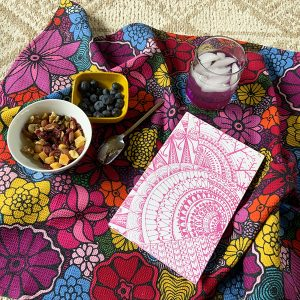 blooming to my highest potential tea towel with pink book cover