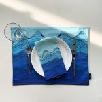 Dining set up with blue ocean placemat