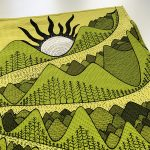 wind, river and mountain - yellow and green tea towel