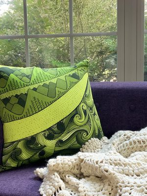 I am a tree hugger - accent pillow in a violet sofa