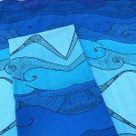 folded blue Ocean wave table napkin