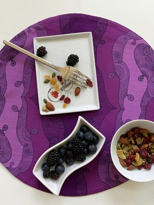 purple placemat - plates wwith raspberry and nuts