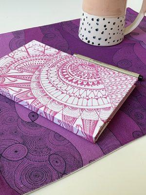 rectangular purple placemat - book and pen