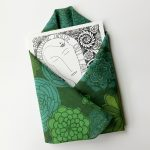 woman art print card enveloped with green squared scarf